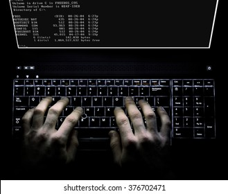 Hacker concept using a computer with stong lighting and dramatic impression