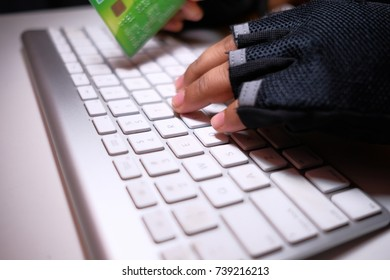 Hacker with Credit Cards on His Laptop Using Them For Unauthorized Payments. Credit Cards Theft Concept