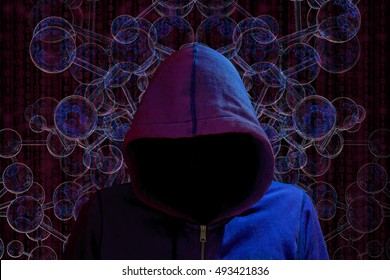 Hacker with dark hoody in red and blue light in front of a spherical network darknet concept
