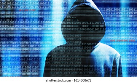 hacker in data security concept with binary code in background.