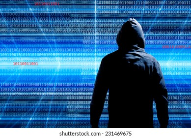 hacker in front of a background with binary code
