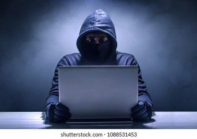 Hacker in front of his computer.