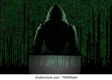 Hacker in front of his computer. Dark face