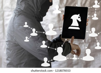 Hacker hacked tablet computer with a horse chess figure on a display. Hacking Cyber Trojan Security Web Network Strategy.