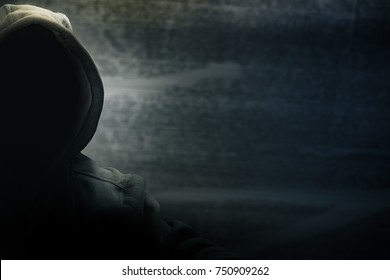 Hacker half face and black head and grunge background, terrorism and internet criminal cyber concept