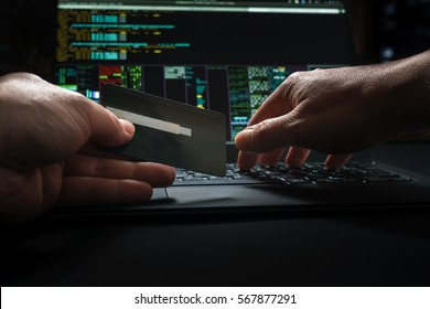 hacker hands, first person view, at work with interface and stolen credit card.