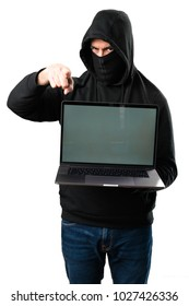 Hacker with his computer pointing to the front on isolated white background