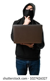 Hacker with his computer thinking on isolated white background