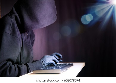 A hacker in his illegal work