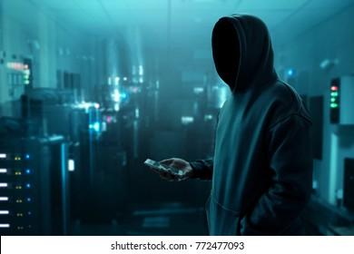 Hacker holding mobile phone