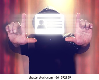 Hacker holding virtual screen with id card icon. Cyber security or id theft concept