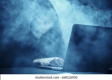 Hacker, laptop, smoke, programmer, work at the computer.