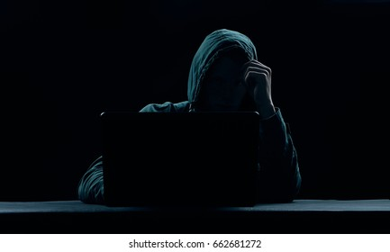 Man Behind Laptop On Dark Background Stock Photo (Edit Now