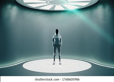 Hacker standing in futuristic gray hall with luminous disc on ceiling. Future and design concept. Mock up.