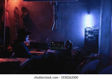 hacker style man, dark room, with red and blue lights, Pontianak, Indonesia March 6, 2021