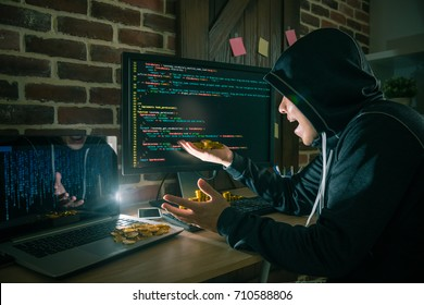 hacker surprised looking at many bitcoin money when he using bad data virus to steal personal information and getting ransom money.