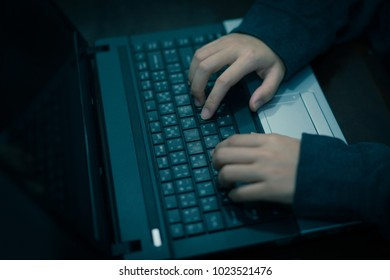 Hacker using laptop to attack computer network. computer or cyber crime concept.