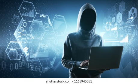 Hacker using laptop with glowing digital interface. Security and malware concept.