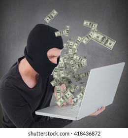 Hacker using laptop to steal identity against light grey