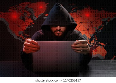 Hacker using laptop and world map on background. Threat of global cyber attack