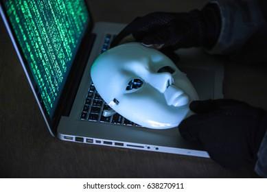 Hacker wear an anonymous mask.