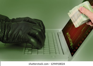 Hacker wearing black gloves using a laptop activating an attack using ransomware, hand handling over the payment in cash