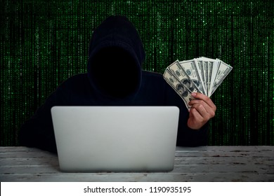 hacker wearing black hooded with computer hacking and stealing big data and finance information showing money on hand with green binary code background
