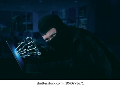 Hacker wearing mask trying to steal identity. Internet security concept