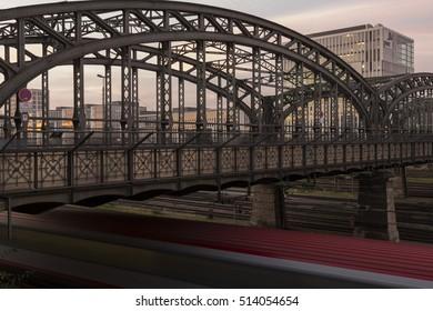 The Hackerbruecke bridge in Munich, Germany, with moving train