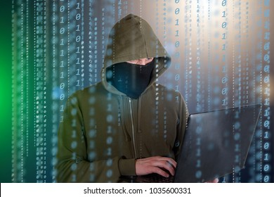 Hackers programmer look on screen and writes the program code hack information and user account.