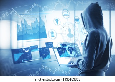 Hacking and hud concept. Side view of hacker in hoodie using laptop with digital business interface on blurry interior background. Double exposure