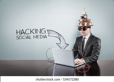 Hacking social media text with vintage businessman using laptop