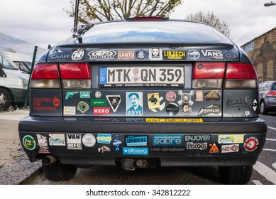 Hackney, London, UK - November 15 2015:  Rear view of a Saab 9-3 covered in stickers. Shot in Hackney Wick, an area in East London popular among young trendy artists and hipsters.
