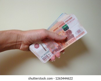 Had holding a wad of money. Russian rubles.
