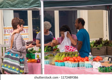 Haddonfield, New Jersey - August 18, 2018: Farmers selling their fruits and vegetables at the farmer's market in this small New Jersey town on this date