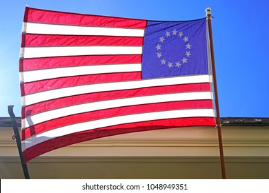 HADDONFIELD, NJ -17 MAR 2018- View of a Betsy Ross flag of the original thirteen colonies of the United States of America on the street in historic Haddonfield, New Jersey.