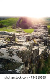 Hadrian's Wall at Walltown Crags with a sun flare looking towards Cumbria.