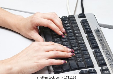 Hads with manicure and computer keyboard