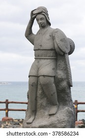 Haenyeo statue of a Korean female diver standing with her catch on a rock. A true icon of Jeju Island and South Korea in general.