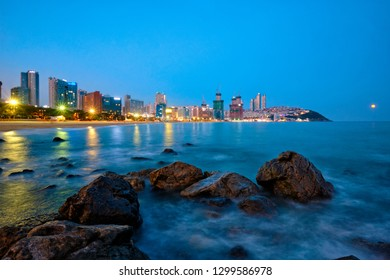 Haeundae beach in Busan at night with illuminated skyscrapers, Busan, South Korea