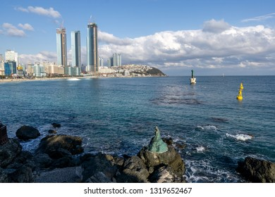 Haeundae beach mermaid statue overlooking the beach area taken near Haeundae Dongbaekseom Island in Busan, South Korea. February 14th 2019