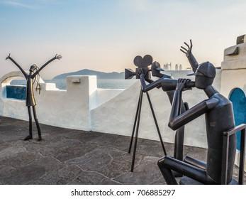 Haeundae, Busan, South Korea - June, 2017: Metal sculptures on the Haeundae promenade promoting the Busan International Film Festival with the Gwangan bridge in the background