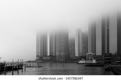 Haeundae-gu, Busan/South Korea - May 17, 2018: Panoramic view of coastline, harbour bay with Promenade and Skyscrapers of Hanwha Resort Haeundae on a foggy day.