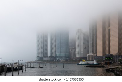 Haeundae-gu, Busan/South Korea - May 17, 2018: Panorama of coastline, harbour bay with Promenade and Skyscrapers of Hanwha Resort Haeundae on a foggy day.