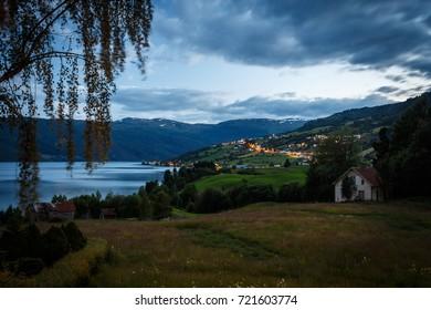 Hafslovatnet lake at night with city