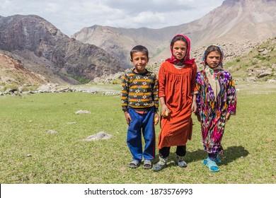 HAFT KUL, TAJIKISTAN - MAY 11, 2018: Young children on a pasture in Marguzor (Haft Kul) in Fann mountains, Tajikistan