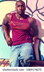 Hagatna, Guam (U.S. Territory) - December 28, 2018: Male fitness model and competitive bodybuilder William Ranson models a purple Nike tank top during a photo shoot with Darron Bruce.