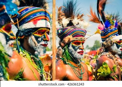 Hagen show, Papua New Guinea - circa August 2015: Three native men during Hagen show, Papua New Guinea. Documentary editorial.