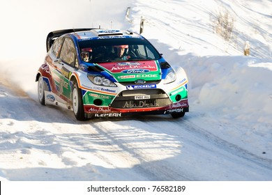 HAGFORS, SWEDEN - FEB 10: Mikko Hirvonen drivning his Ford Fiesta RS WRC during the World Rally Championship event Rally Sweden in Hagfors, Sweden on Feb 10, 2011.  Winner WRC Rally Sweden 2011