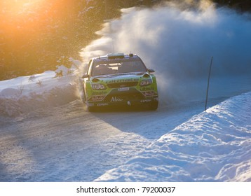 HAGFORS, SWEDEN - FEB 13: Mikko Hirvonen drifting his Ford Focus WRC rally car during Rally Sweden 2010 in Hagfors, Sweden on February 13, 2010